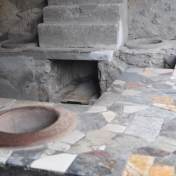 A typical food house, or restaurant. This was taken in an area of Pompeii that is being restored based on historical research. The bench top is amazing!