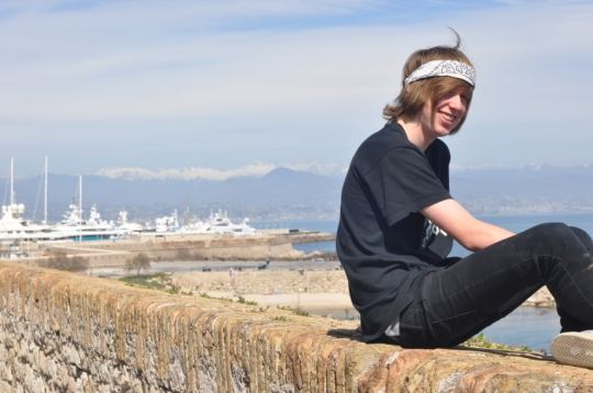 My son sitting on the stone wall lining the beach front at Antibes - because everything had gone wrong whenever we visited the place I was petrified he would fall and be a mangled mess on the other side!!