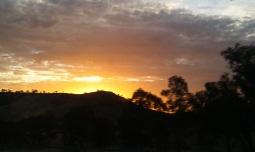 Sunset driving between Uluru and Alice Springs