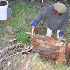 Lining the pit walls with wood